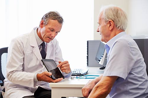 This image shows a senior patient and his doctor.