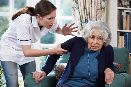 A nursing home employe acting aggressive towards a resident.
