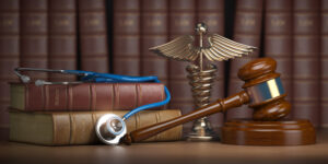 This is an image of book and stethoscope on desk of lawyer that is filing an Arkansas paraquat lawsuit