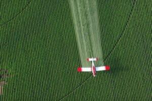 Paraquat sprayed by plane, paraquat class action lawsuit concept
