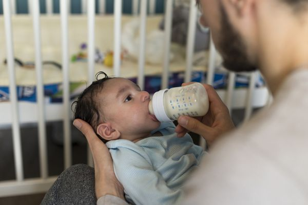 father in arkansas feeding infant formula to baby